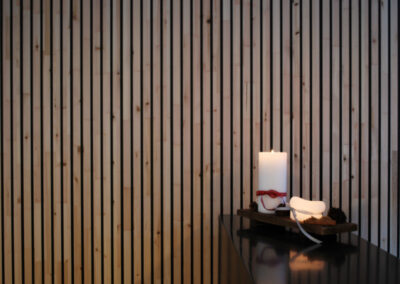 Solid wood walls panels with black painted slats.