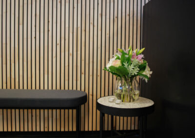 Wooden wall covering with black painted slats. Product: NORTO Bech