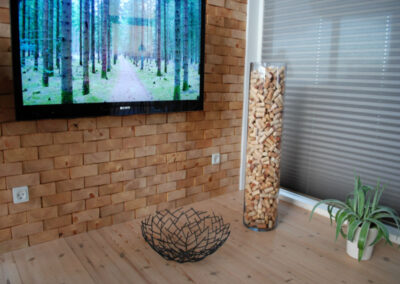 Living room with a wall of untreated solid wood blocks.