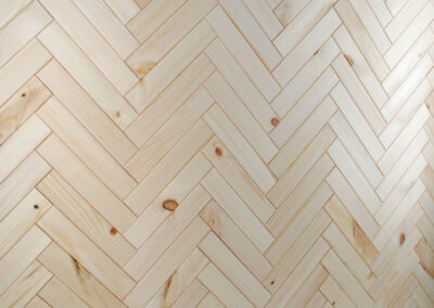 Wooden wall covering in a herringbone pattern