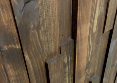 Brown oiled wood lamellas for wall covering