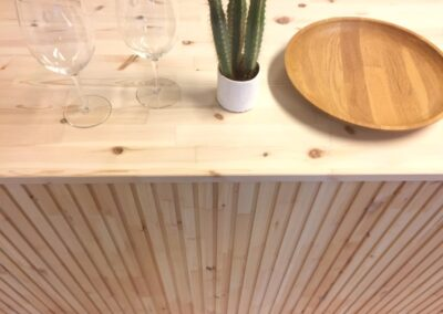 Kitchen front made of untreated wooden slats
