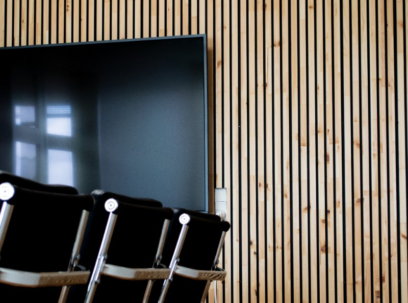 Wooden wall panels mounted on the wall in a meeting room