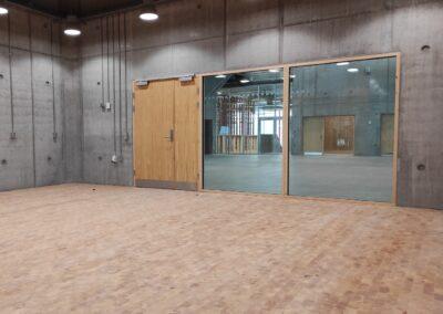 Træklodser til gulv i New Aarch (Århus Arkitektskole)